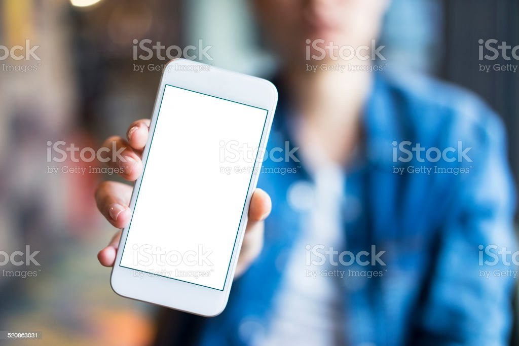 Young woman showing smartphone screen stock photo