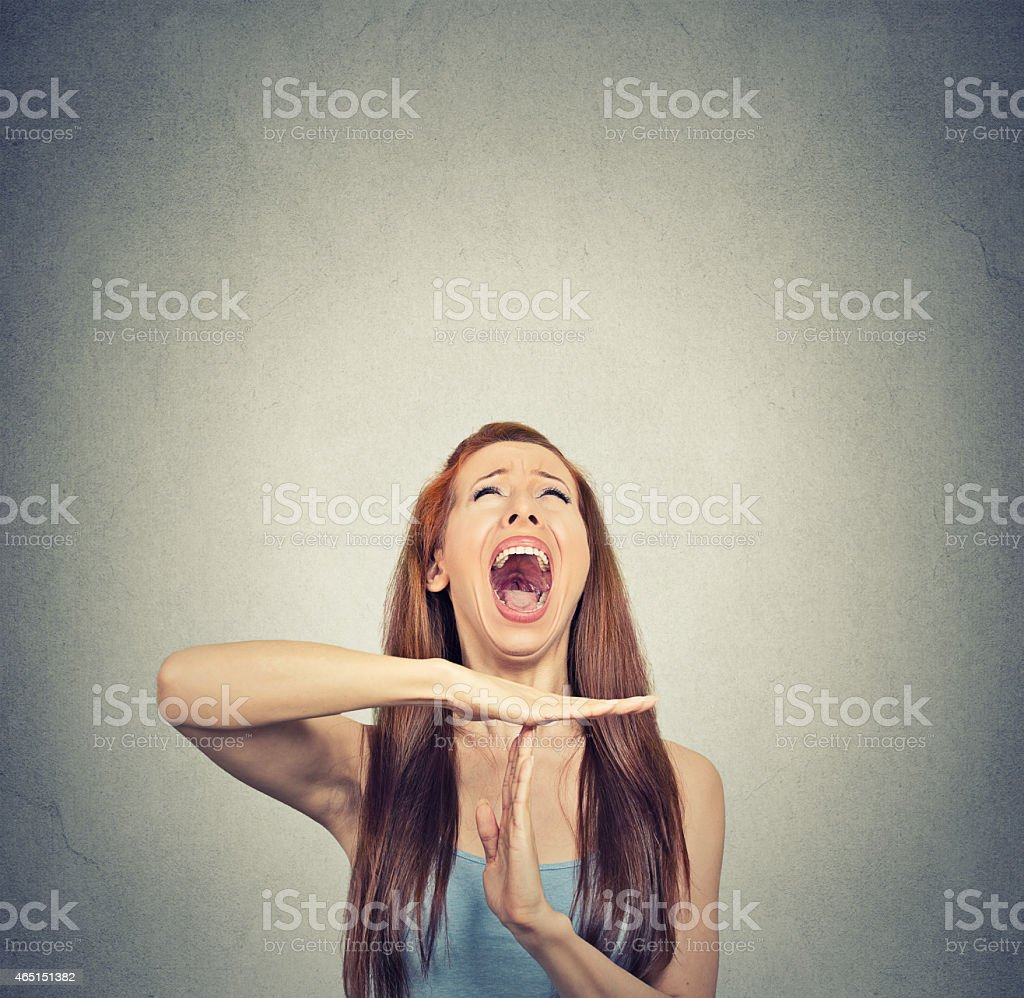 Young woman showing time out hand gesture, frustrated screaming stock photo