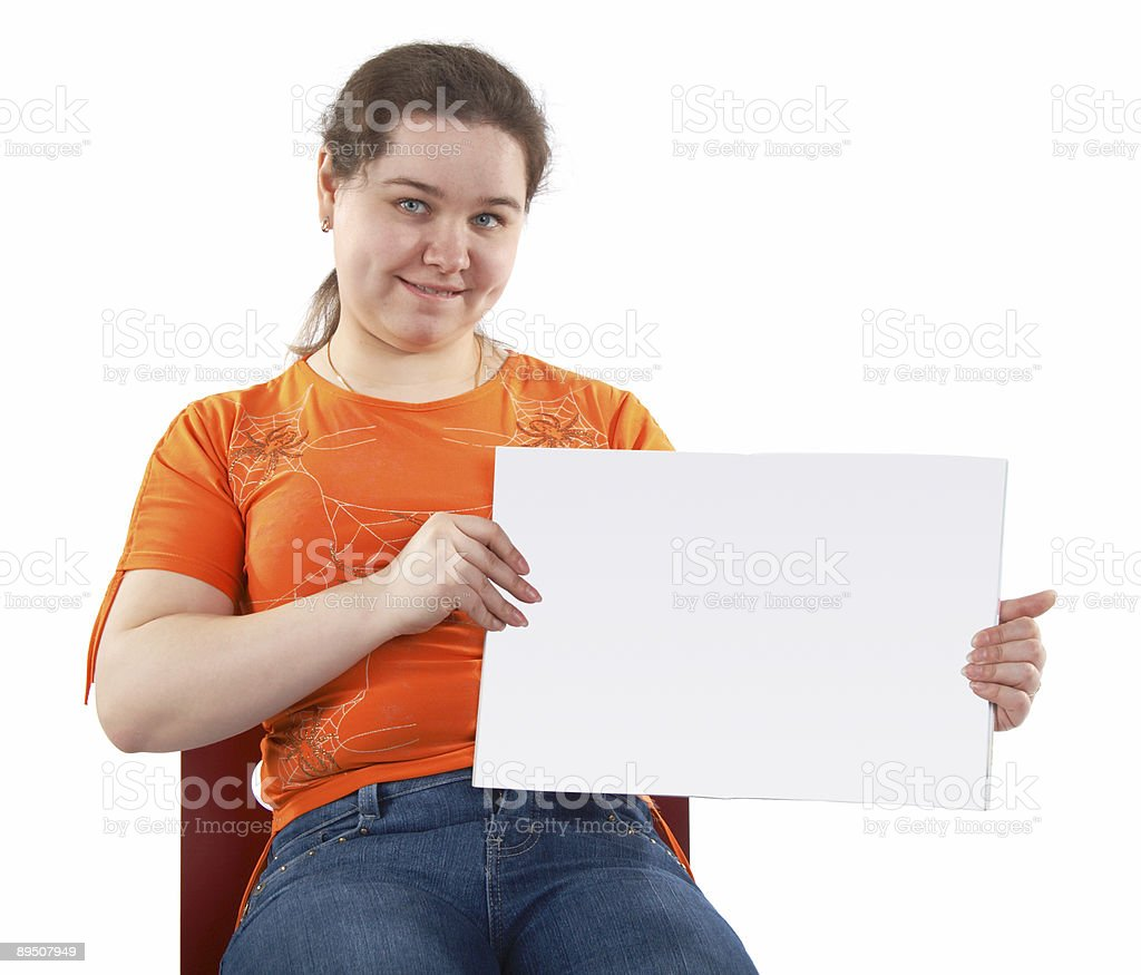 Young woman shows blank card royalty-free stock photo