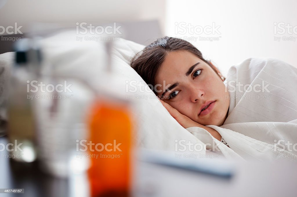 Young Woman Sick in Bed royalty-free stock photo