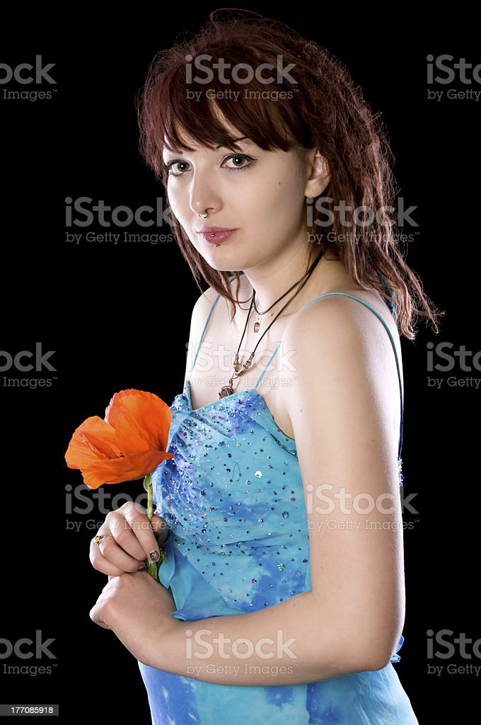 Young woman, side view, with poppy. stock photo