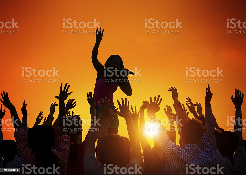 Young Woman Singing in Front of the Audience stock photo