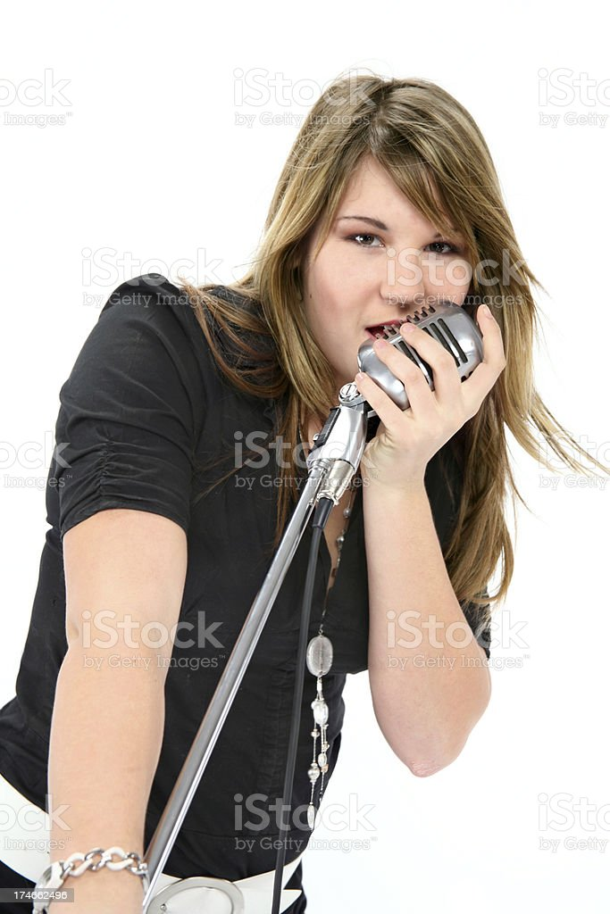 young woman singing in retro micro royalty-free stock photo