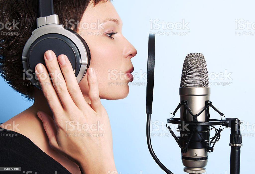 Young Woman Singing in Studio Mic