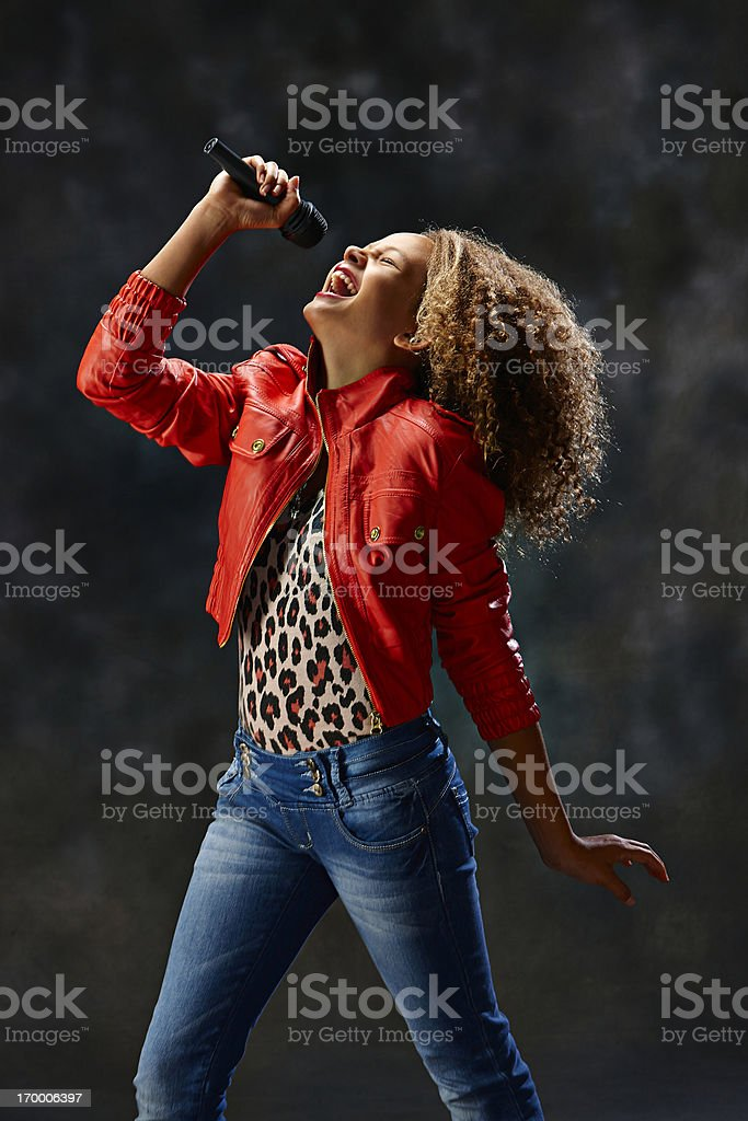 Young woman singing royalty-free stock photo