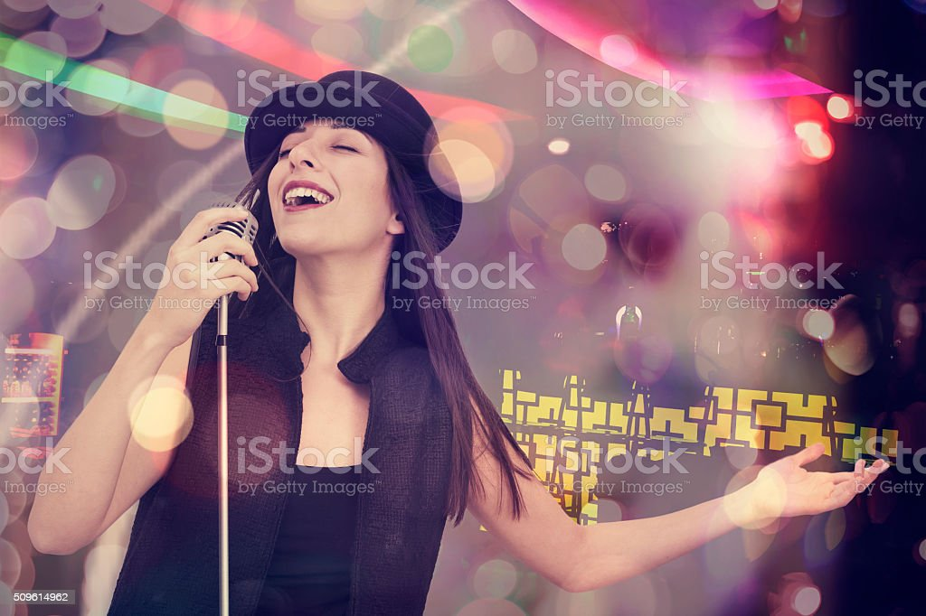 Young woman singing with the microphone stock photo