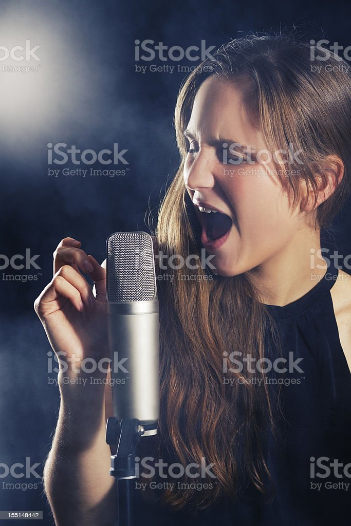 Young Woman Sings at Jazz Concert stock photo