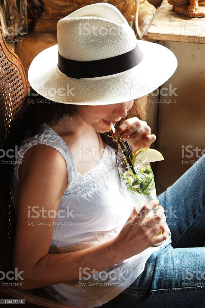 Young Woman Sipping Cocktail royalty-free stock photo