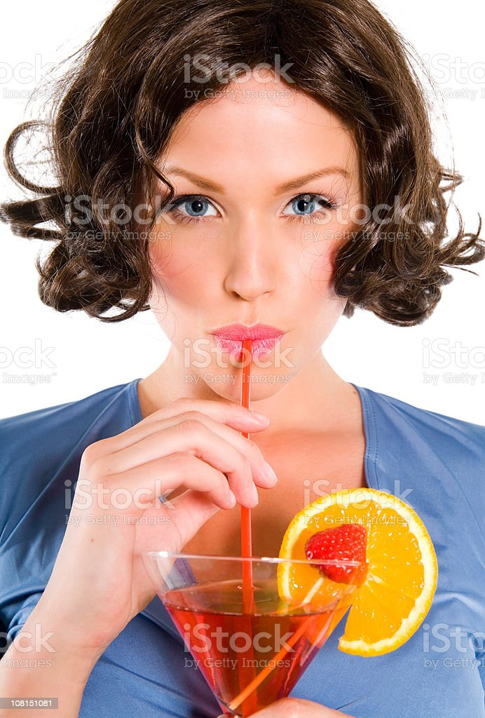 Young Woman Sipping Cocktail stock photo