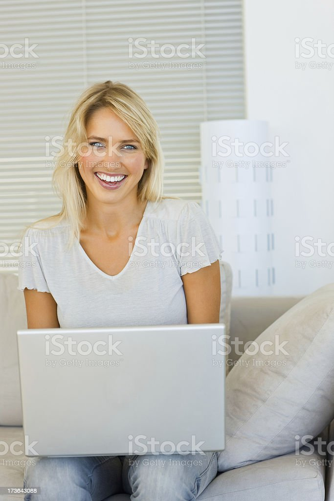 Young woman sitting and using laptop royalty-free stock photo
