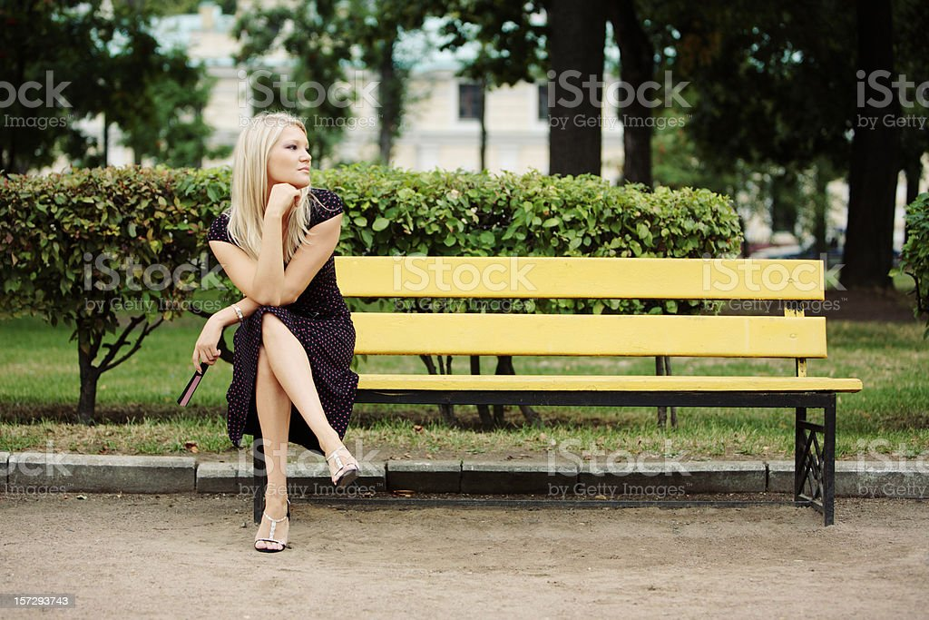 Young woman sitting and Waiting stock photo
