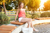 Young woman sitting at bench
