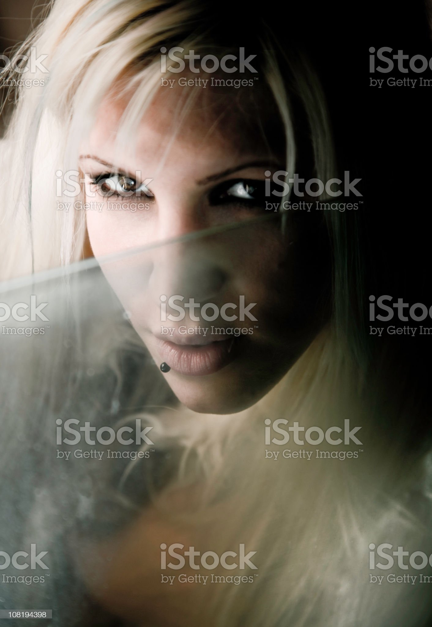 Young Woman Sitting Behind Frosty Car Window royalty-free stock photo
