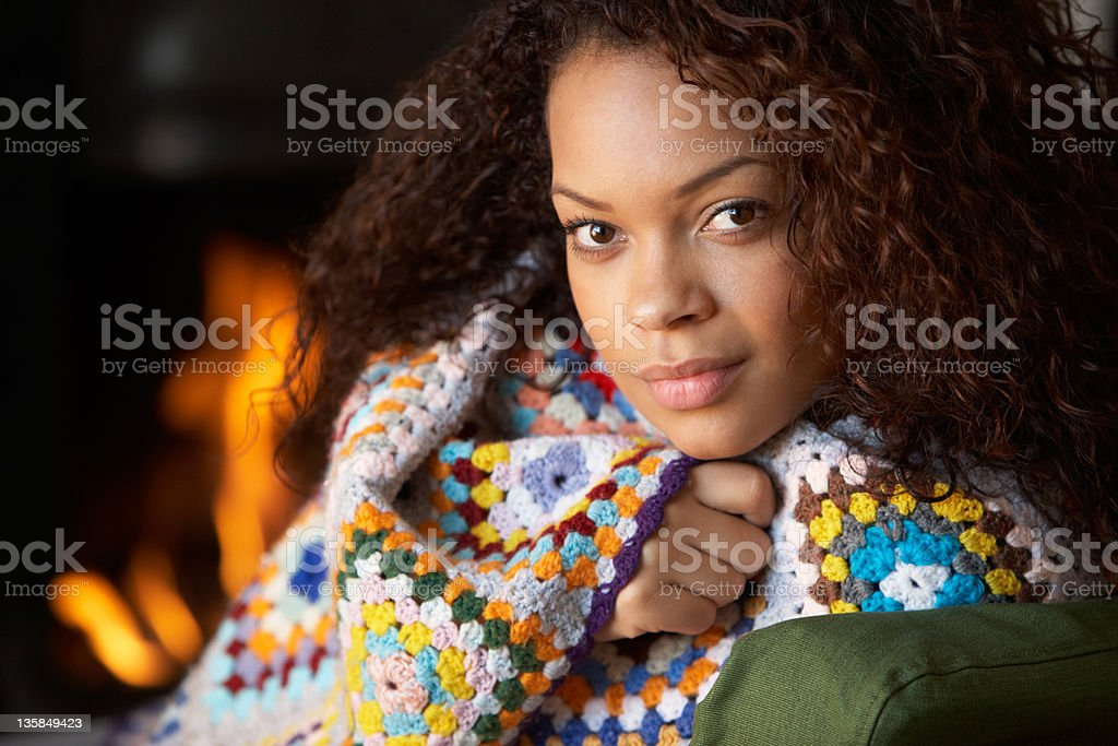 Young woman sitting by open fire royalty-free stock photo