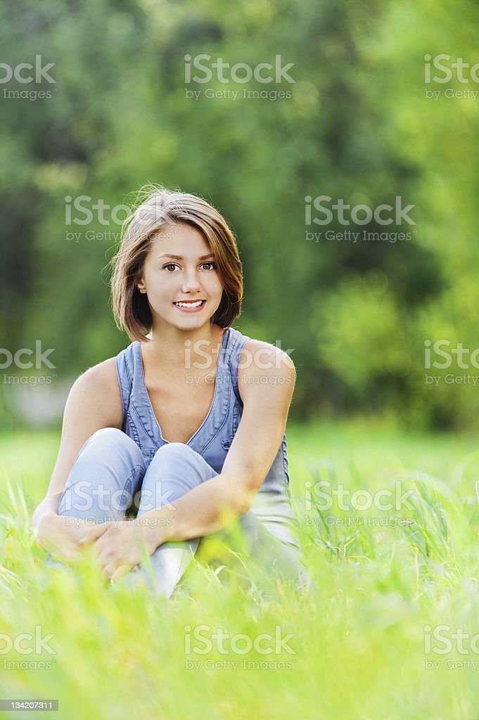 young woman sitting grass royalty-free stock photo