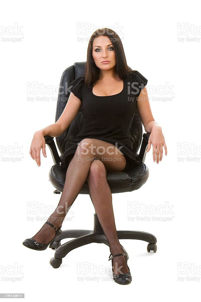 Young woman sitting in an office chair stock photo