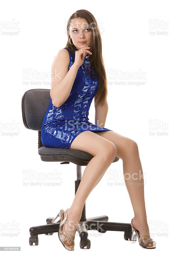 Young woman sitting in an office chair royalty-free stock photo