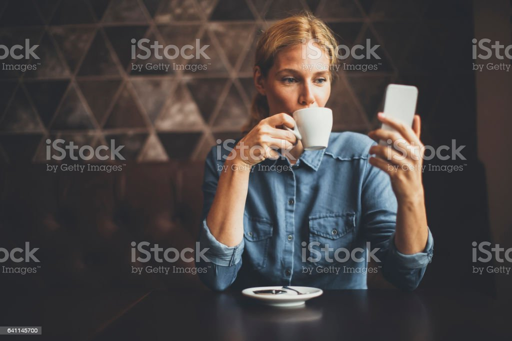 Young woman sitting in cafe stock photo