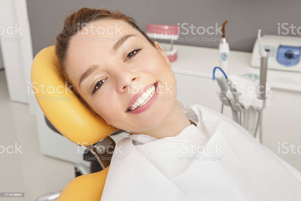 Young woman sitting in dental chair royalty-free stock photo