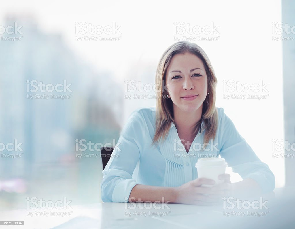 Young woman sitting in office meeting stock photo