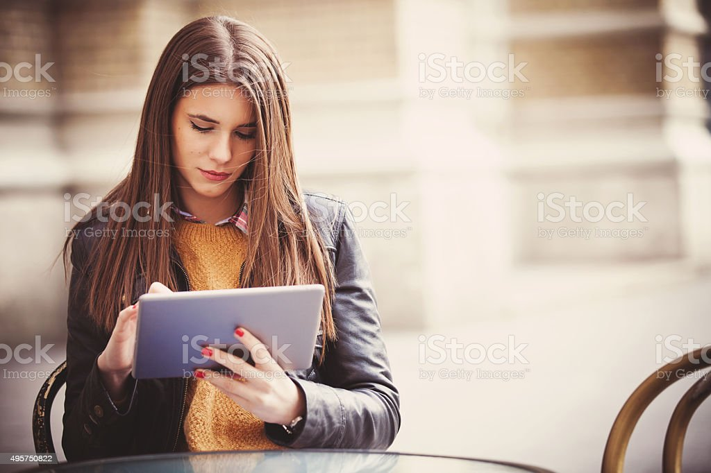 Young woman sitting in the cafe with digital tablet stock photo