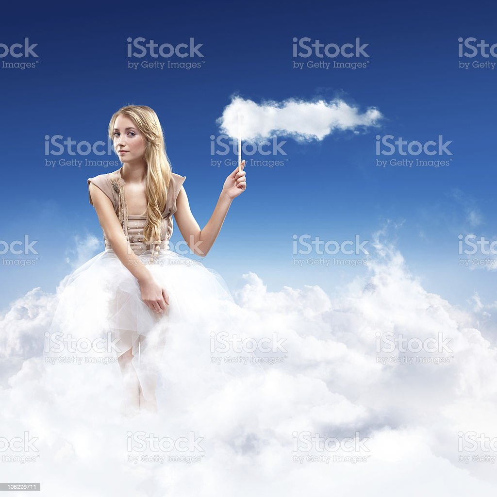 Young Woman Sitting in the Sky on Clouds stock photo