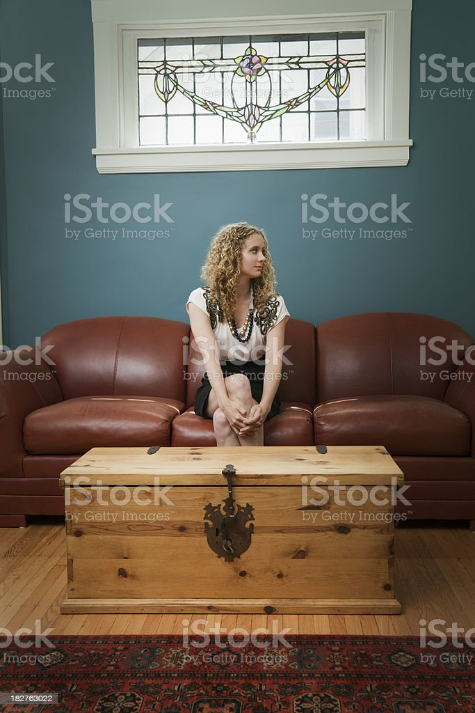Young Woman Sitting, Leather Sofa, Stained Glass Window, Living Room royalty-free stock photo