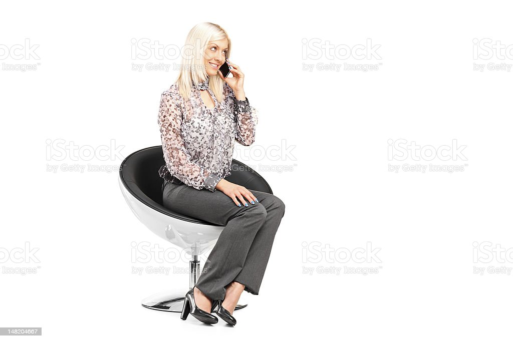 Young woman sitting on a chair royalty-free stock photo