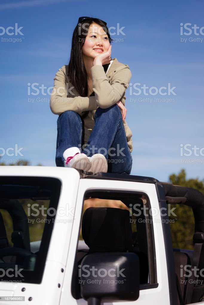 Young Woman Sitting on an Off Road Vehicle stock photo
