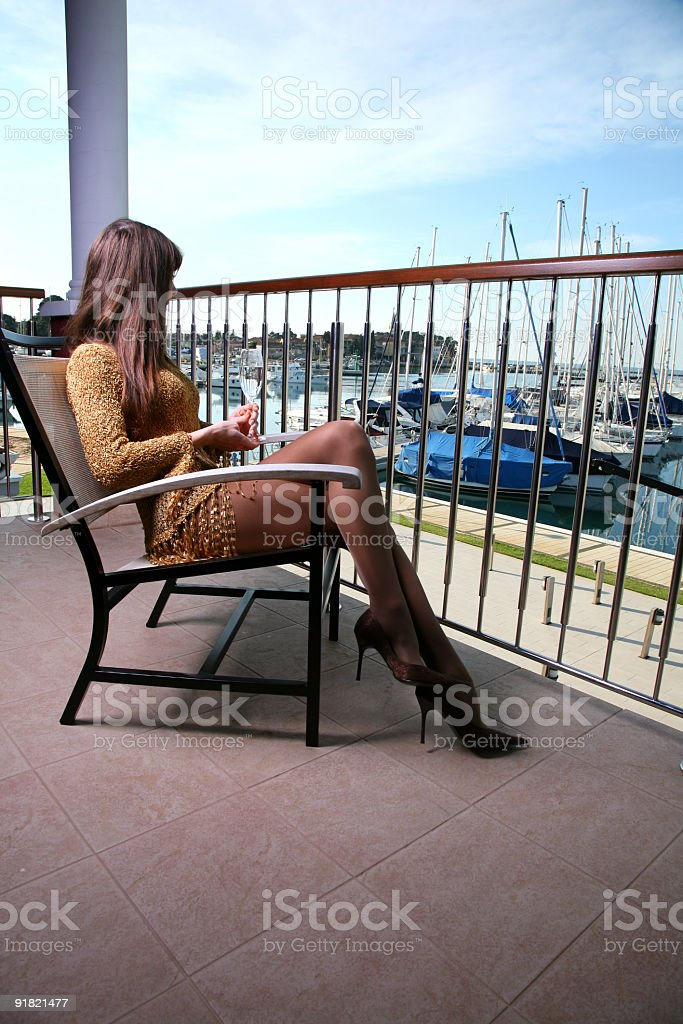 Young woman sitting on balcony royalty-free stock photo