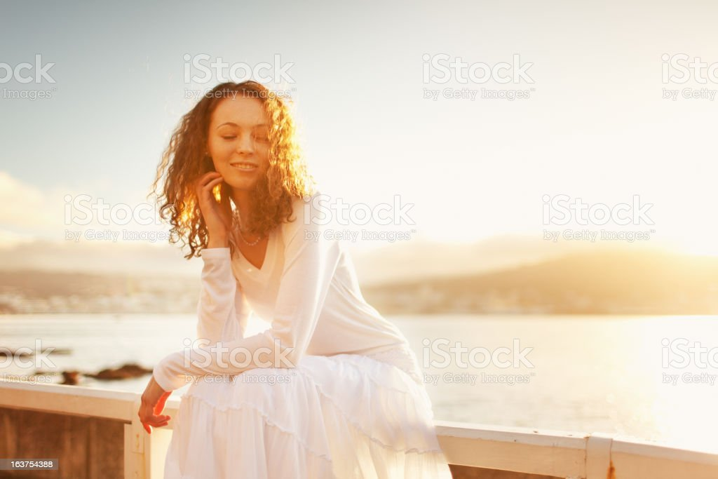 Young Woman Sitting on Beach royalty-free stock photo