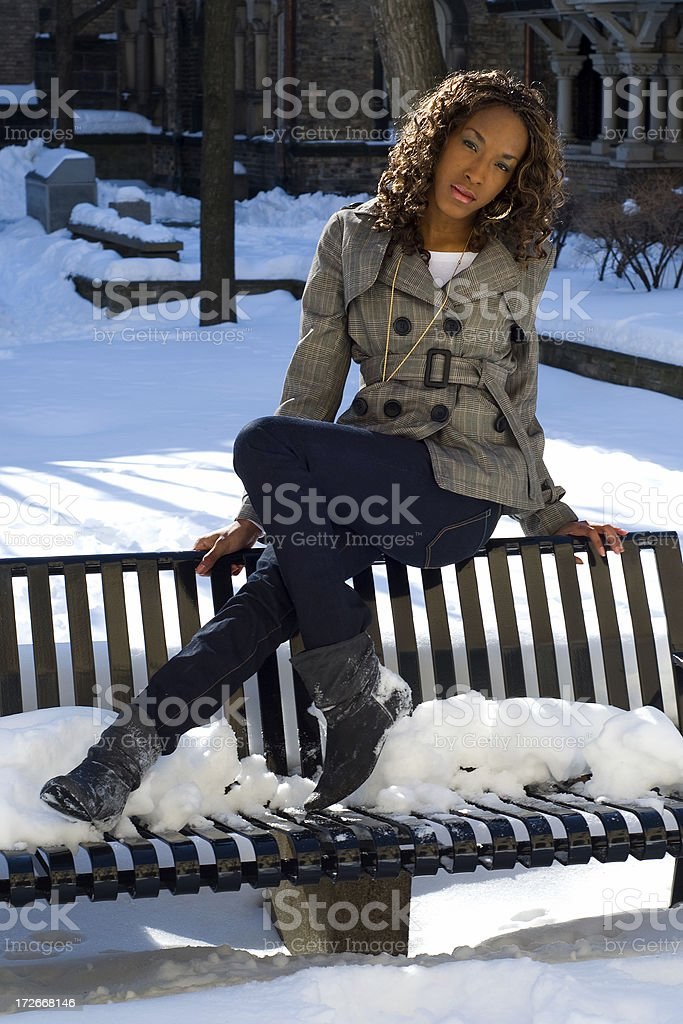 Young woman sitting on bench. stock photo