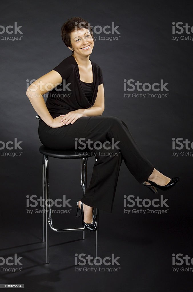 Young woman sitting on chair royalty-free stock photo