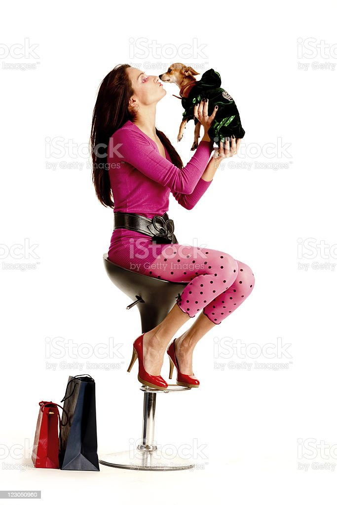 Young Woman sitting on chair with chihuahua royalty-free stock photo
