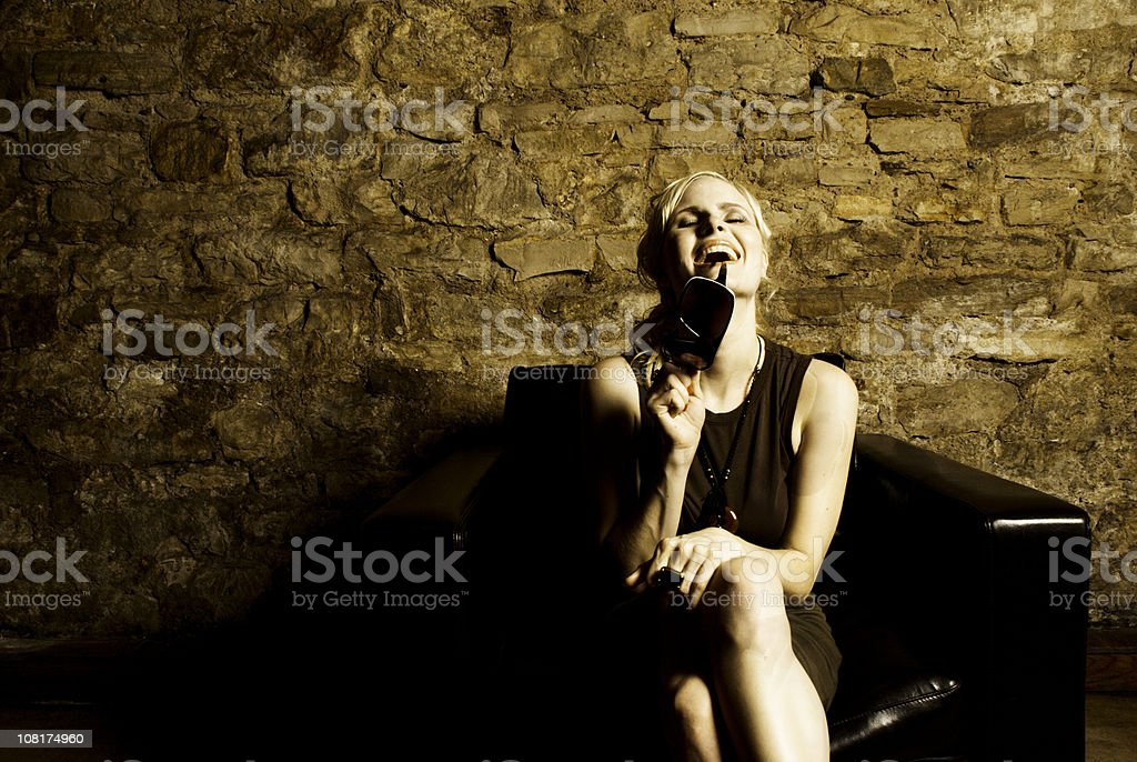 Young Woman Sitting on Couch royalty-free stock photo