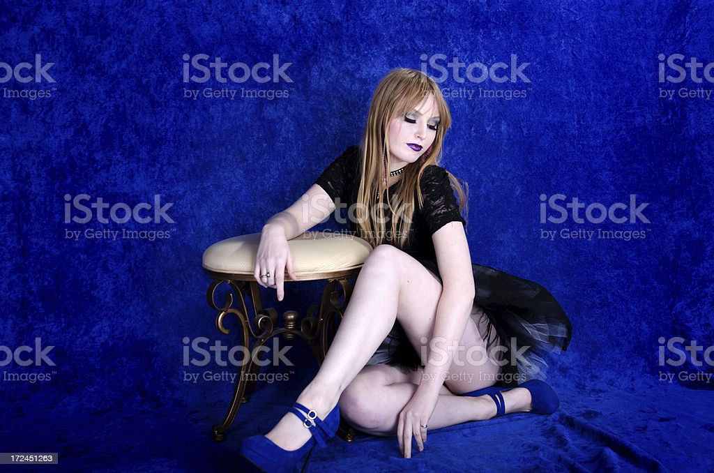 Young woman sitting on floor, looking away. royalty-free stock photo