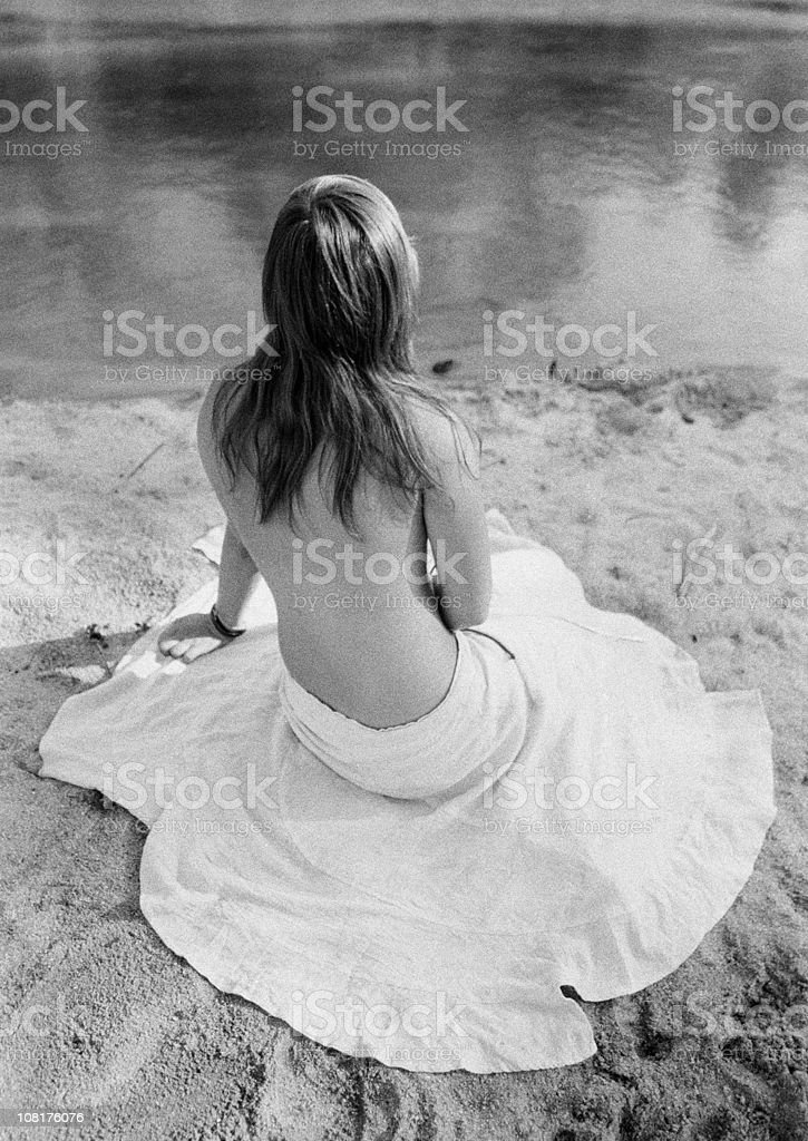 Young Woman Sitting on River Bank, Black and White royalty-free stock photo