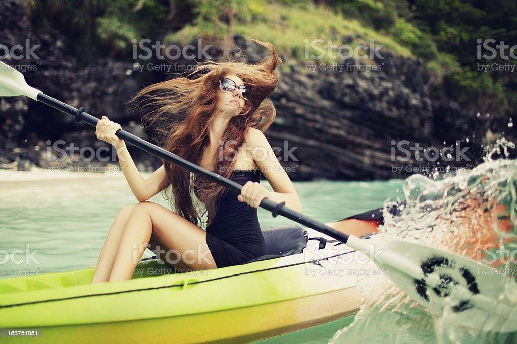 Young woman sitting on sea kayak stock photo