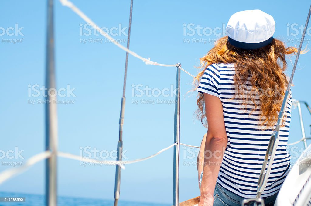 Young woman sitting on the boat stock photo