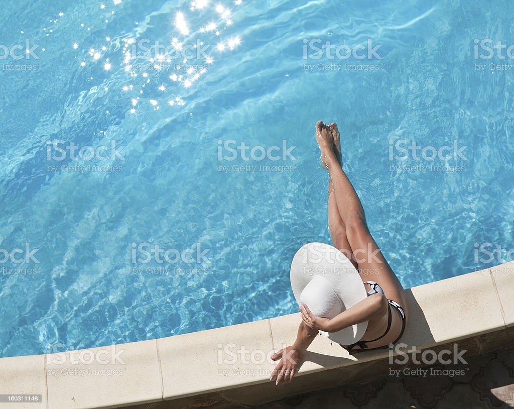 Young woman sitting on the pool. royalty-free stock photo