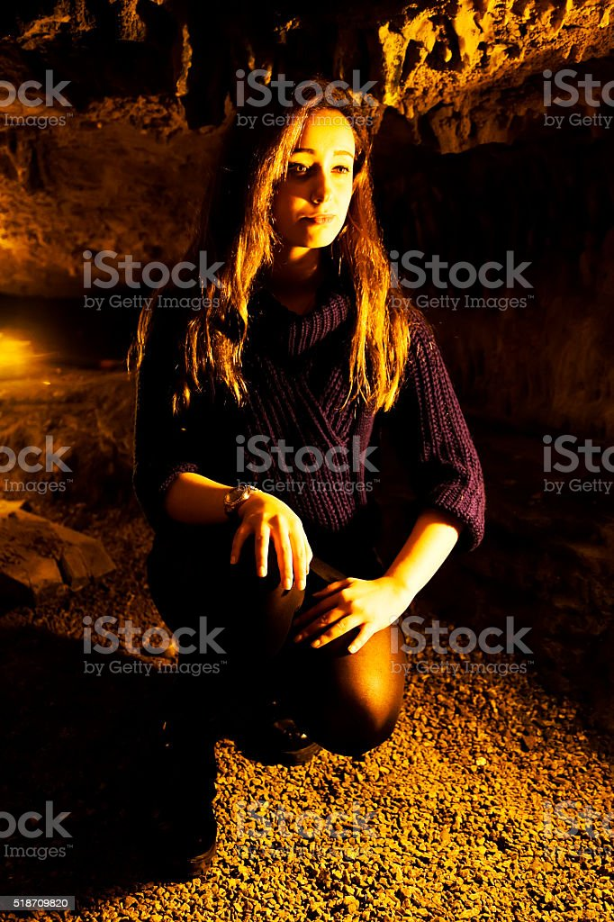 Young woman sitting stock photo