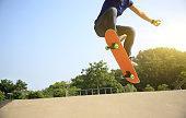 young woman skateboarder skateboarding at skatepark