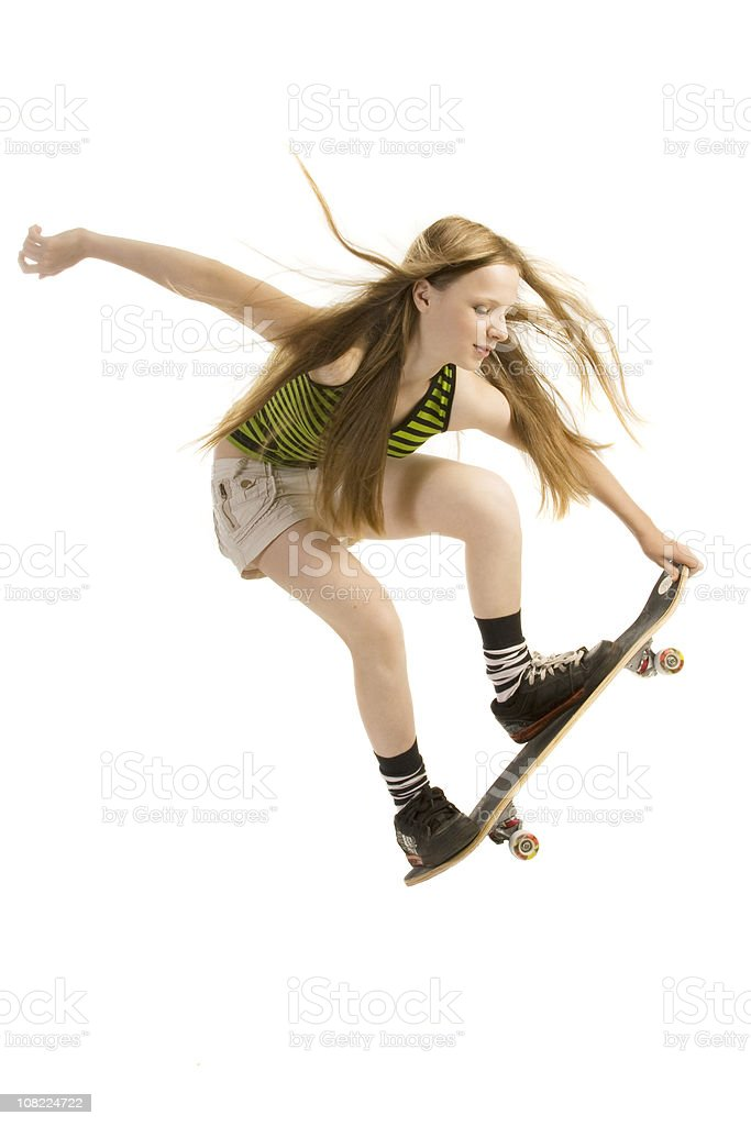 Young Woman Skateboarding, Isolated on White stock photo