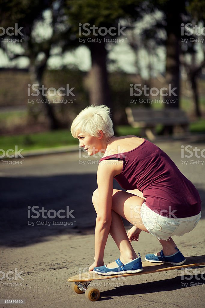 Young woman skateboarding royalty-free stock photo