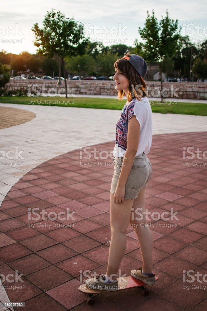 Young woman skateboarding stock photo