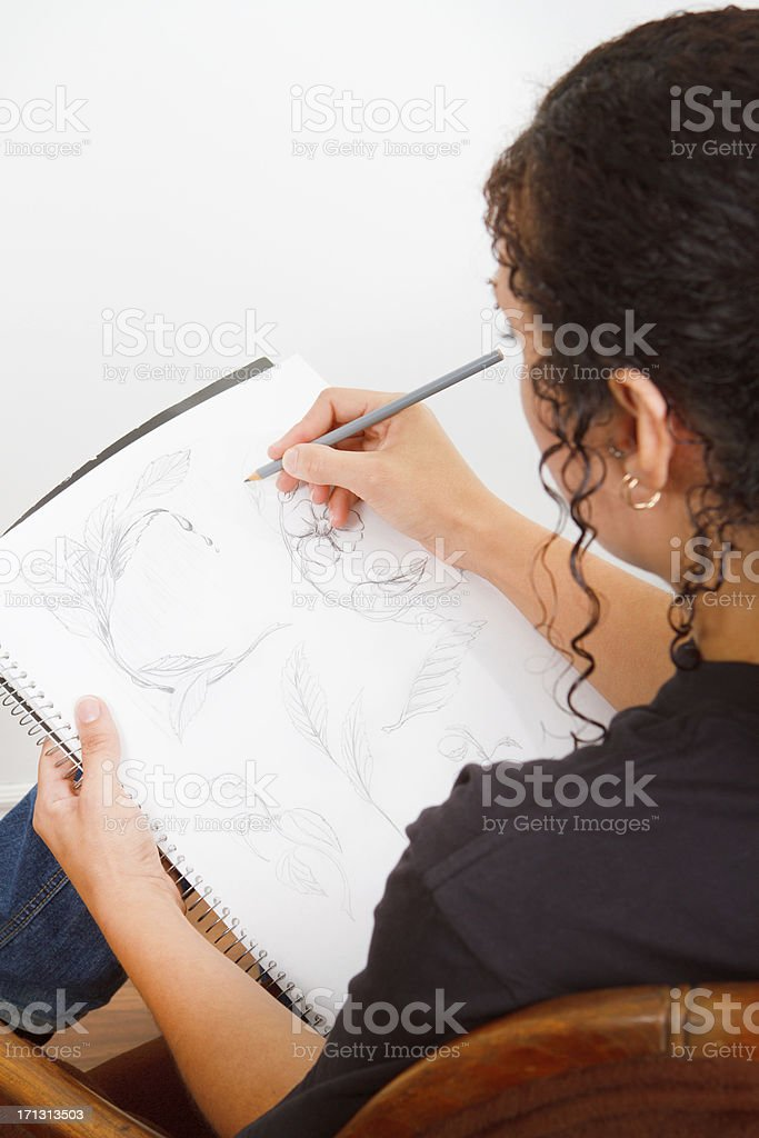 Young Woman Sketching royalty-free stock photo
