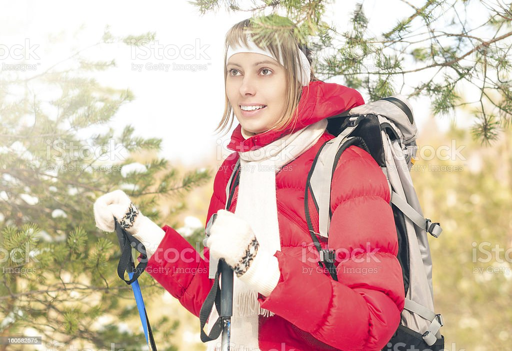 Young woman skiing in forest on winter sunny day. royalty-free stock photo