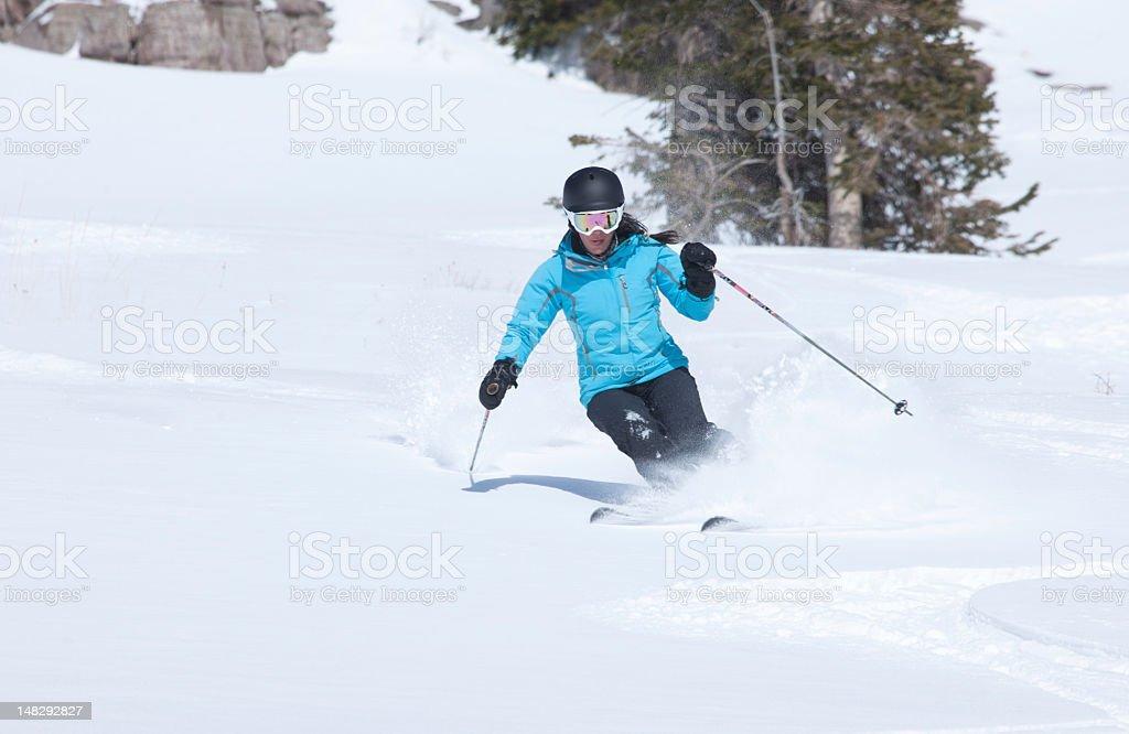 Young woman skiing in powder snow, Colorado, USA. stock photo