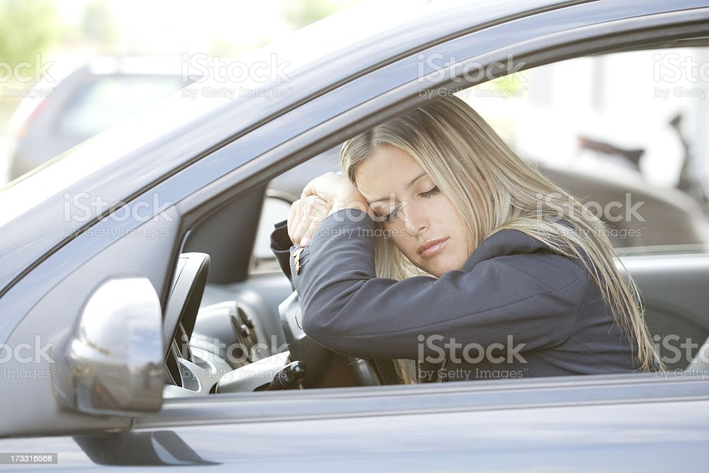 young woman sleeping in car royalty-free stock photo