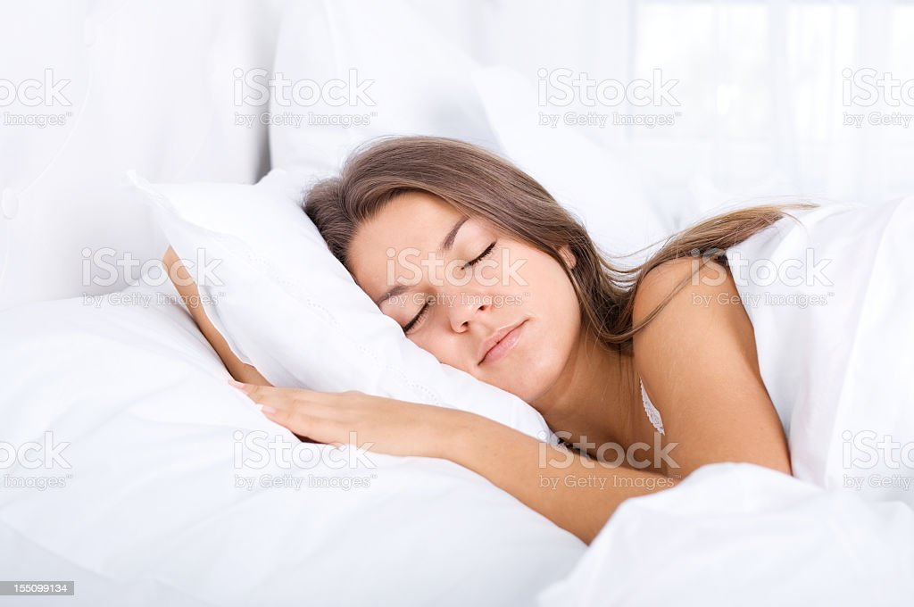 Young woman sleeping in her bed royalty-free stock photo